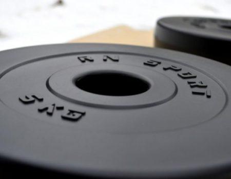 67 кг (2х1.25, 2х2.5, 2x5, 2х10 и 2x15) дисков, покрытых пластиком (31 мм)